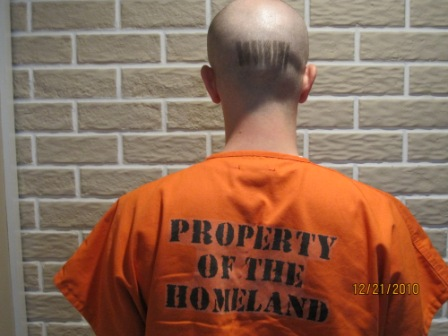 Man wearing shirt which reads 'property of the homeland'