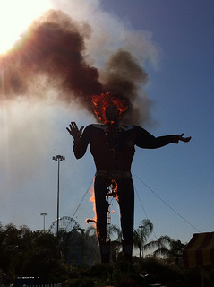 statue of Tex burning